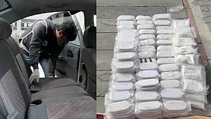 Adana'da otomobilde 52 kilogram esrar ve 70 bin uyuşturucu hap ele geçirildi